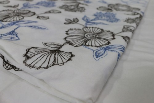Charcoal Blue flower embroidery on off white bedsheet
