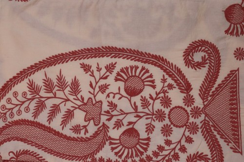 Maroon  paisley embroidery on Peach bedsheet