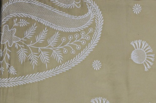 White paisley embroidery on beige bedsheet